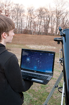 Student with telescope